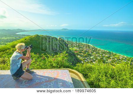 Travel photographer takes shot of Lanikai Beach and Kailua Beach in Oahu East shore, Hawaii, USA. Nature photographer taking pictures outdoors during hawaiian hiking Lanikai Pillbox Hike.