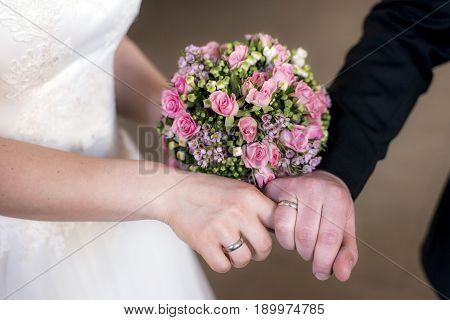 hands of groom and bride with wedding rings celebration
