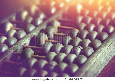 vintage wooden abacus on wood table used for calculating.