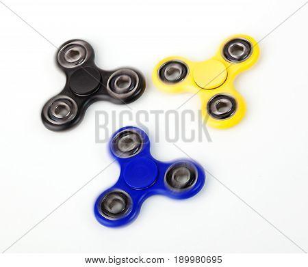 Three Fidget Spinner On White Background