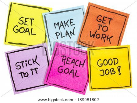 set goal, make plan, work, stick to it, reach goal - a success concept presented with isolated colorful sticky notes