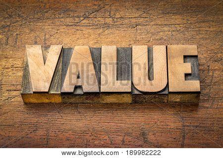 value word abstract in vintage letterpress printing blocks against rustic wood