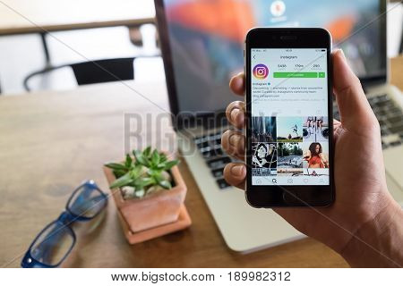 CHIANG MAI THAILAND - AUG 2 2016: A man holds Apple iPhone with Instagram application on the screen. Instagram is a photo-sharing app for smartphones.