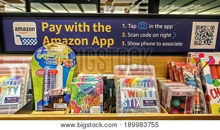 New York June 1 2017: Instructions on how to make purchases using Amazon application are posted alongside some items for sale in a newly opened Amazon Books store in Time Warner Center.