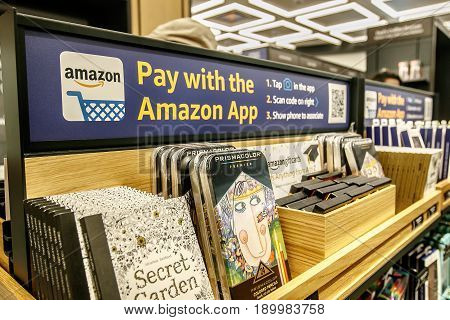 New York June 1 2017: Various merchandise items are put on display in a newly opened Amazon Books store in Time Warner Center. Instructions on how to make purchases using Amazon application are posted alongside.
