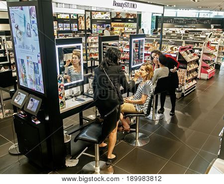 New York June 1 2017: Female customers of Sephora are having makeup applied to their faces by the store's stylists.