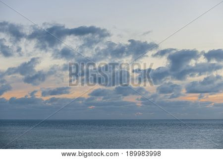 Turquoise water of calm ocean and cloudy sky after sunset at Florida Keys