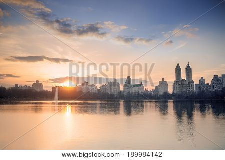 New York City's Central Park Reservoir and west side Manhattan skyline at sunset