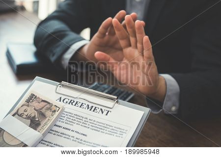 Businessman giving money Japanese Yen with the agreement to his partner - bribery and corruption concepts