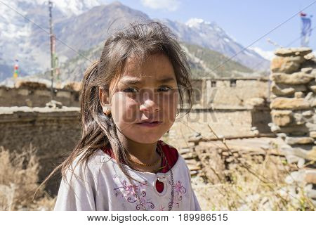 HIMALAYAS ANNAPURNA REGION NEPAL - OCTOBER 17 2016 : Portrait nepalese child on the street in Himalayan village Nepal