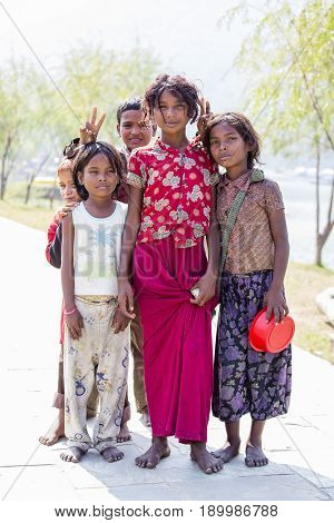 HIMALAYAS ANNAPURNA REGION NEPAL - OCTOBER 23 2016 : Portrait nepalese poor children on the street in Himalayan village Nepal