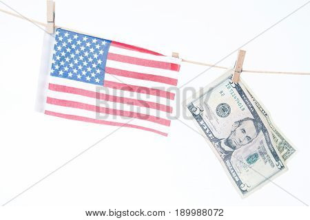 American flag and dollars hanging on a rope Memorial Day or 4th of July