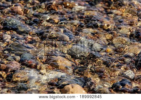 small stones in river transperent clean whater
