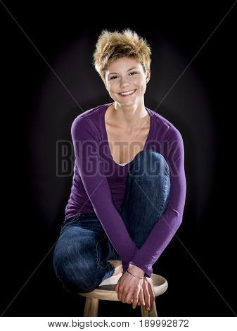 Caucasian woman smiling on bench
