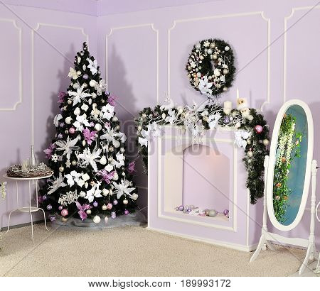 decorated family room with christmas tree for holiday