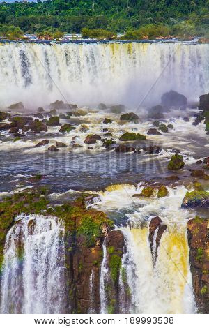 Iguazu Falls National Park - waterfalls on the border of Argentina, Brazil and Paraguay. Multistage complex of waterfalls creates strong noise and water dust