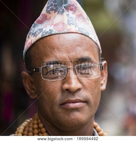 KATHMANDU NEPAL - SEPTEMBER 28 2016 : Portrait old men in traditional dress in street Kathmandu Nepal