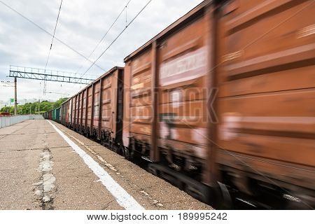 The Freight Train In Motion Is Passing By The Station. Russian Railways
