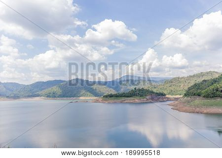 Beautiful landscape of natural dam mountain and water reservoir under cloudy sky natural irrigation system.