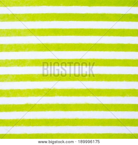 Green and white striped pattern on mulberry paper textured background detail close-up