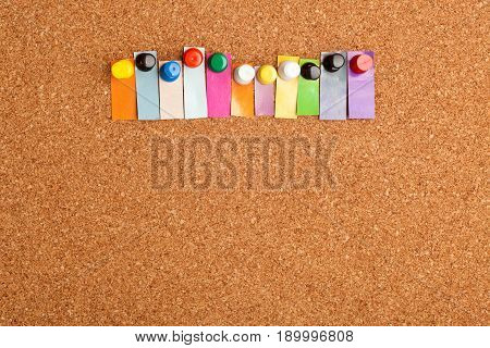 Cork board and colorful heading with copyspace for a eleven letter word