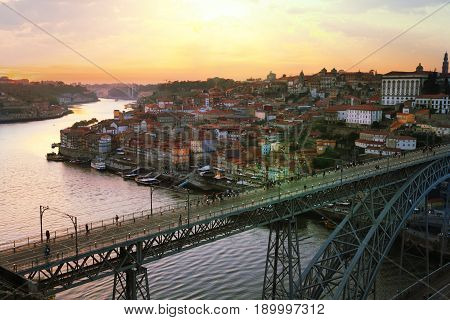 Porto city view with Douro river and Dom Luis I bridge in the setting sun Portugal