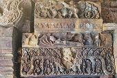 Ornamental carved stone lintel showing Vishnu reclining on the serpent Ananta Sesha (Narai Bantomsin) at Ku Phra Kona group of Khmer prangs or pagodas Roi Et Thailand poster