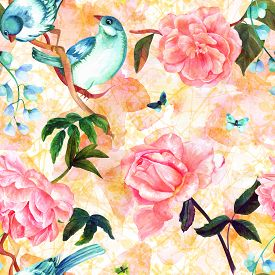 Seamless pattern with watercolor drawings of vibrant teal blue birds, blooming pink roses, camellias, and peonies, and butterflies, hand painted on a pastel background of abstract branches