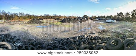 Wide Angle View Of Piles Of Tires And Other Trash (rubbish) At The Abandoned Furber's Scrapyard In S