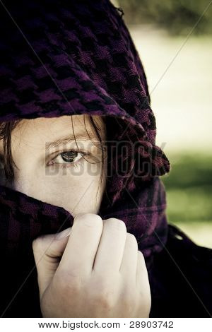 Staring woman portrait covered by violet veil