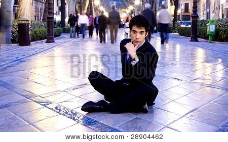Businessman portrait in urban background.