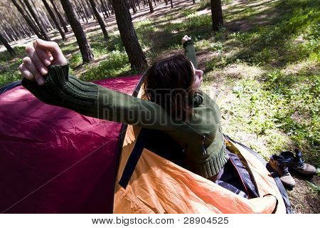 Young mountaineer waking up in the morning