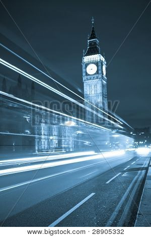 Nocturne scene with Big Ben behind light beams, blue toned.
