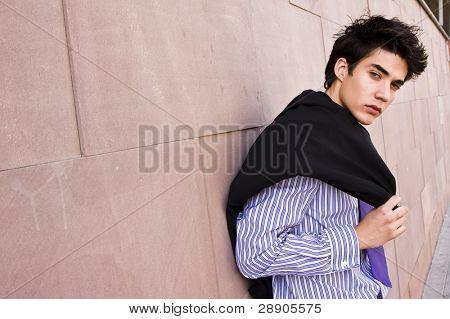 Lone businessman posing on wall