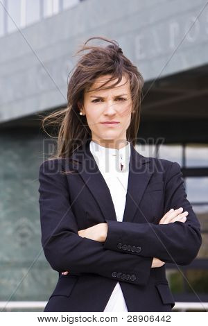 Young serious businesswoman staring at camera