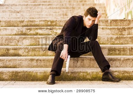 Armed man in stairs poster