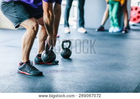 An Athlete Who Is Engaged In Functional Training Raises A Small Weight While Performing An Exercise