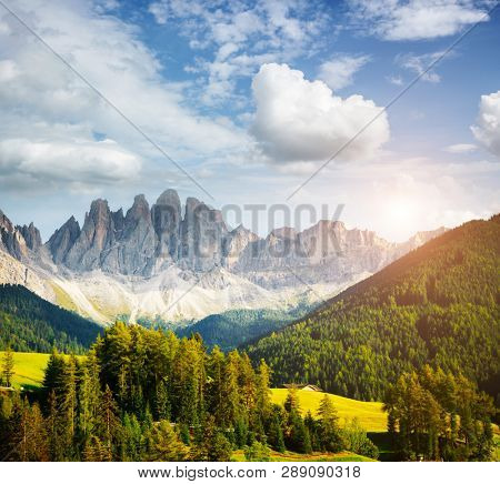 Splendid landscape in St. Magdalena or Santa Maddalena village. Location place Val di Funes (Villnob), Dolomite alps, Trentino-Alto Adige, Italy, Europe. Famous resort. Discover the beauty of earth.