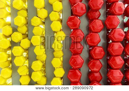 Photo Of A Background Of Dumbbells Which Consists Of 50 Of Yellow Of Red Dumbbells A Conceptual Phot