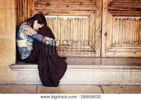 Sad elegant woman sitting and crying