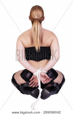 Sexy Submissive Woman Isolated On White Background. Back View. Bondage Concept.