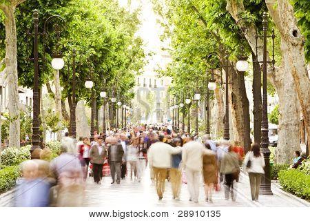 Blurred crowd in the street, high key.