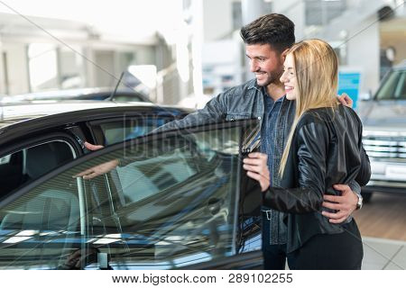 Car dealer new car concept, couple choosing a car
