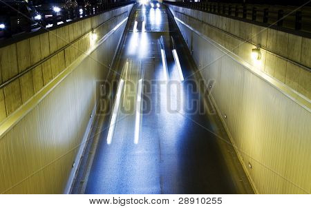 Long exposed lightbeams in urban street.