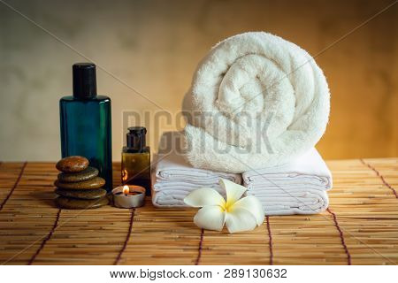 Spa Oil Massaging Treatment And Skincare Concept., Component Of Therapy Massage With Plumeria Or Fra