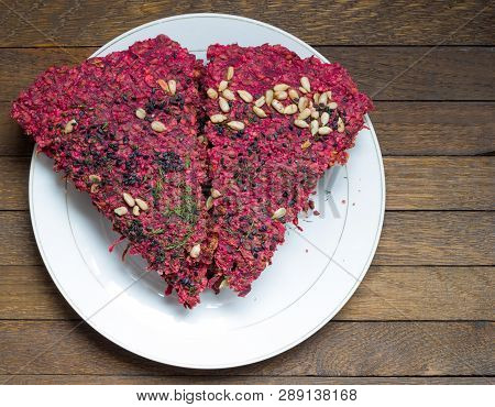 Dry Beet Vegan Bread On White Plate On Wooden Table With Copy Space