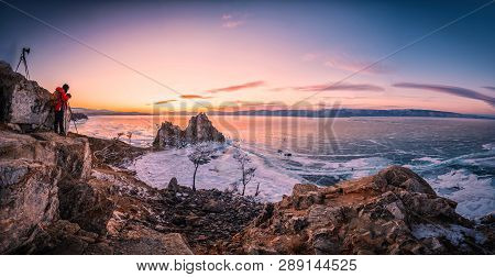 Landscape Of Shamanka Rock At Sunset With Natural Breaking Ice In Frozen Water On Lake Baikal, Siber
