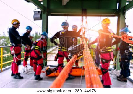 Rescue Team In Action Practicing Training For The Use Of Ropes For Rescue Of High Buildings . Select