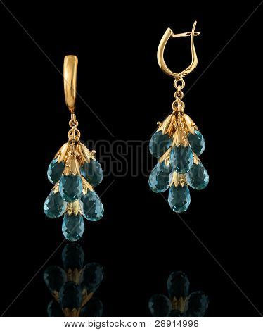 Gold Earrings Isolated On Black