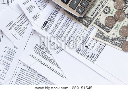 Us Tax Forms.tax Forms Background. The Concept Of Tax Settlement. Tax Forms Background. The Concept